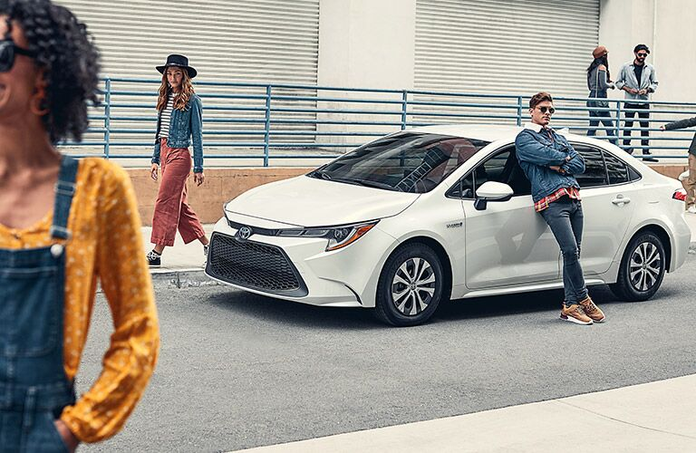 2021 Toyota Corolla Hybrid with people around it