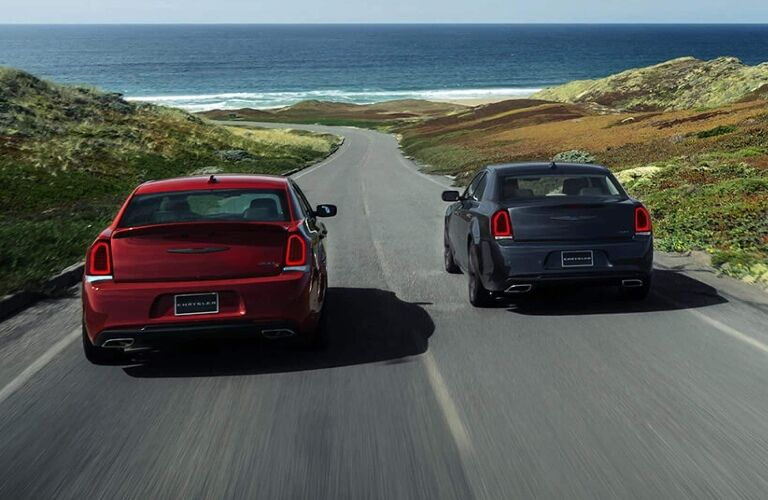 Two 2021 Chrysler 300 sedans driving away