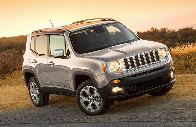2019 Jeep Renegade driving off-road at sunset