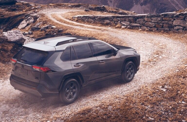 2020 Toyota RAV4 driving down gravel path