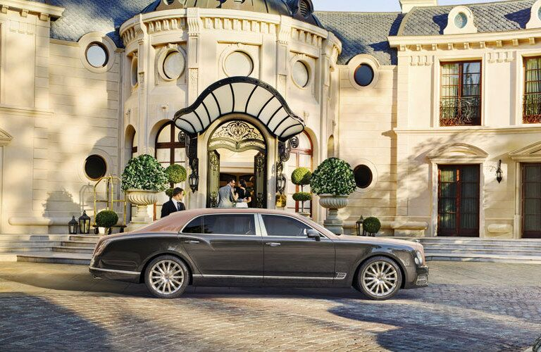 Brown 2020 Bentley Mulsanne parked in front of a mansion