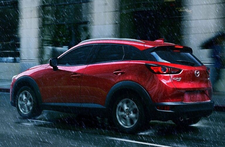 2021 Mazda CX-3 driving away in the rain