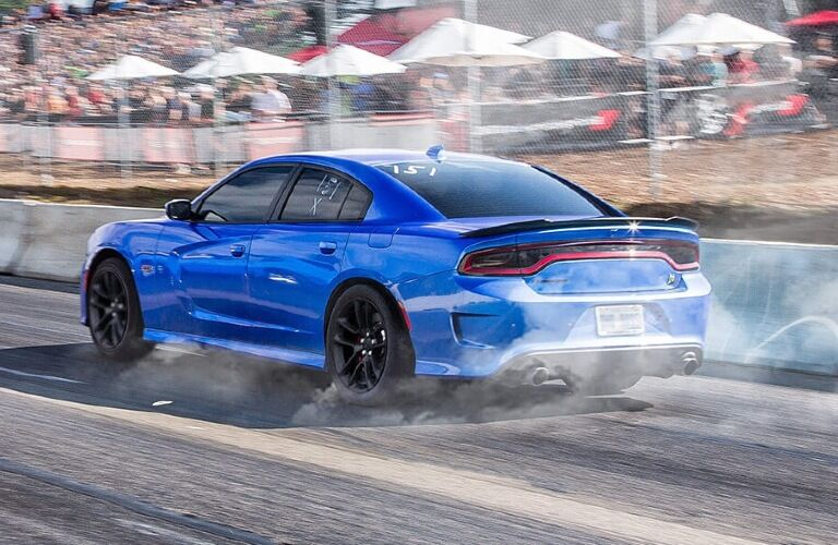 2020 Dodge Charger driving away on a racetrack
