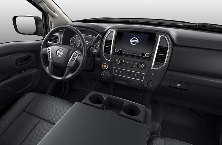 Interior view of the front seating area inside a 2020 Nissan Titan