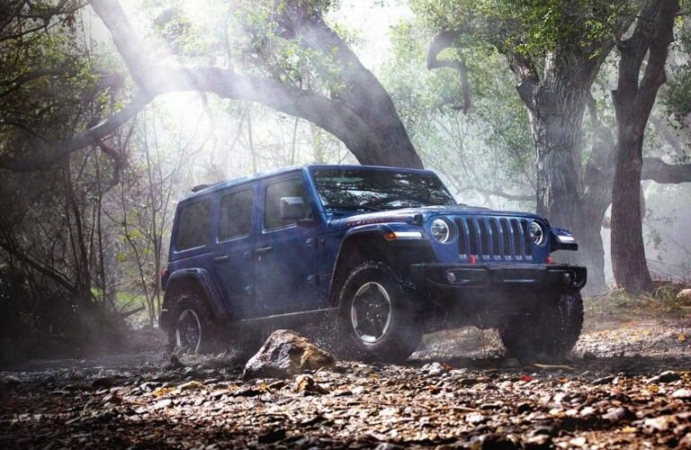 2020 Jeep Wrangler blue front side view in the forest
