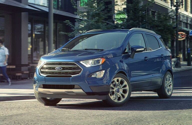 Front view of blue 2019 Ford EcoSport driving through city