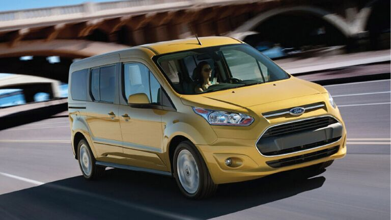 Front view of yellow 2015 Ford Transit Connect