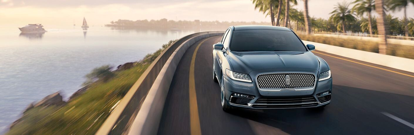 Blue-Grey 2019 Lincoln Continental driving on a coastal road