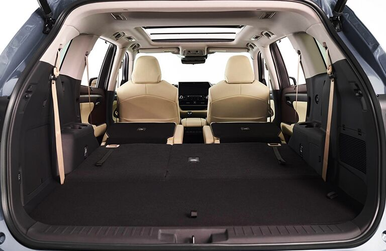 The rear seating and cargo area inside a 2020 Toyota Highlander.