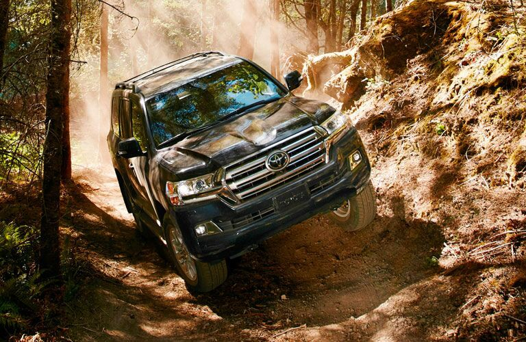 Black 2020 Toyota Land Cruiser Front Exterior on Rocky Trail