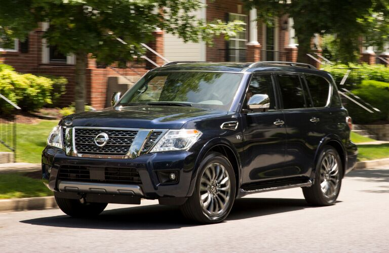 Front view of dark blue 2020 Nissan Armada on residential street