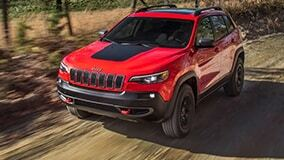Red Jeep Cherokee driving