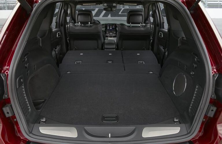 Interior view of the rear cargo area inside a 2020 Jeep Grand Cherokee