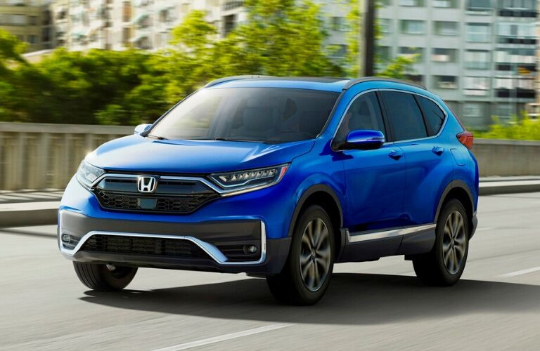 Front view of blue 2020 Honda CR-V Touring on city street
