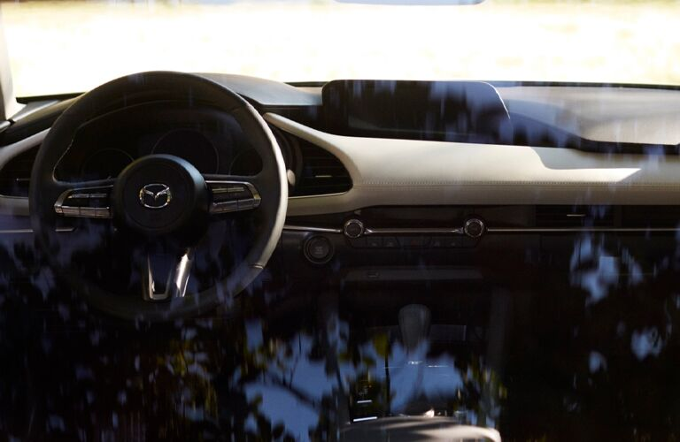 The steering wheel area inside the 2021 Mazda3 Sedan