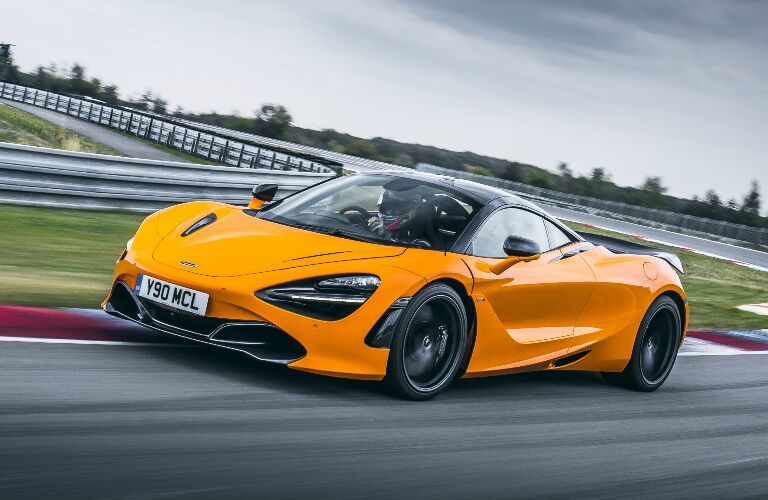 Orange 2020 McLaren 720S driving on a racetrack