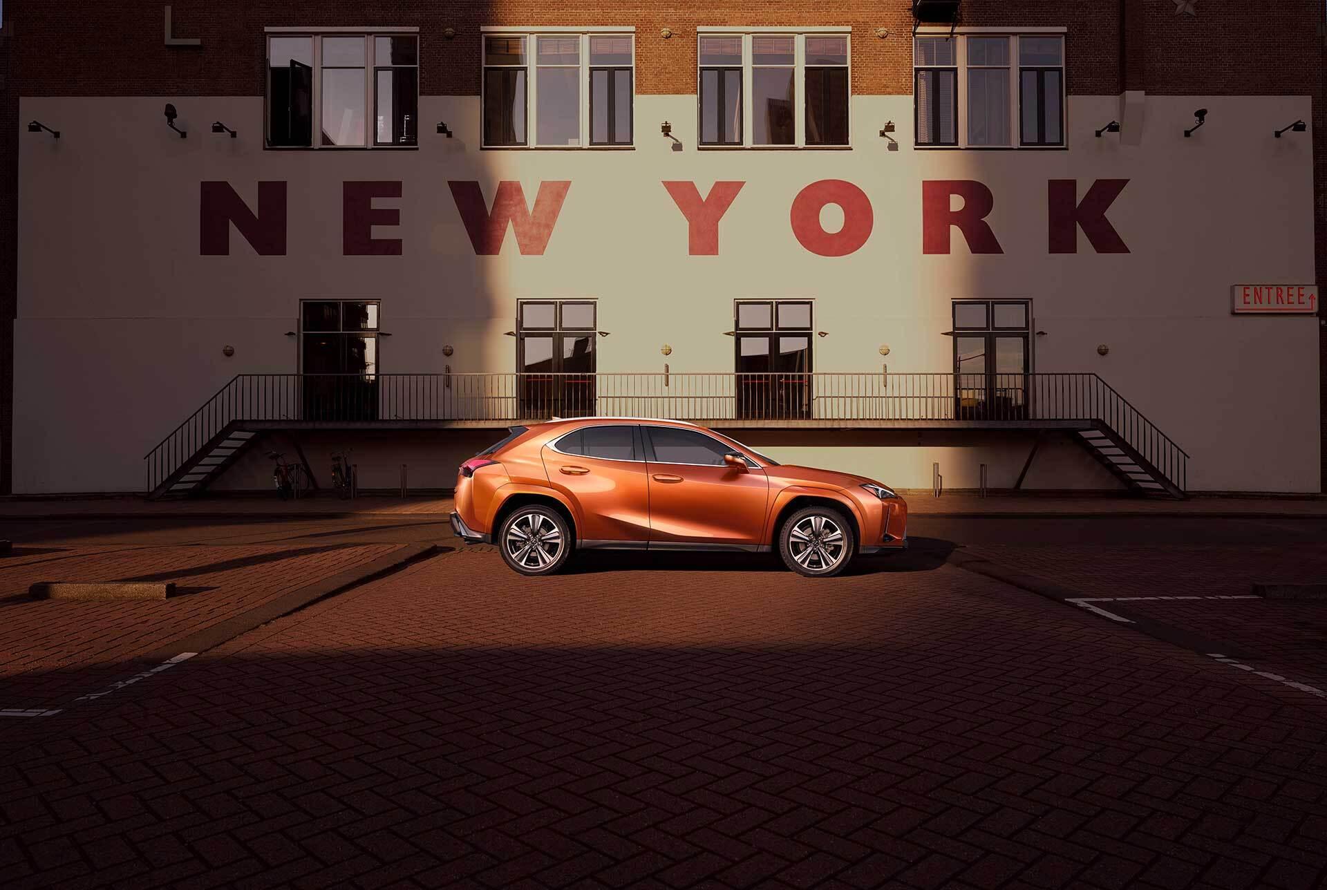 Exterior of the Lexus UX shown in Cadmium Orange.