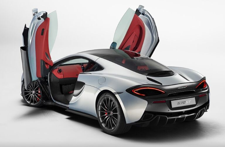 Rear view of silver 2020 McLaren 570GT with butterfly doors opened