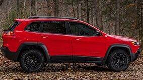 Red 2019 Jeep Cherokee side