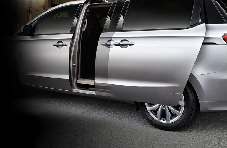 Exterior side of the 2021 Kia Sedona with the second door opening