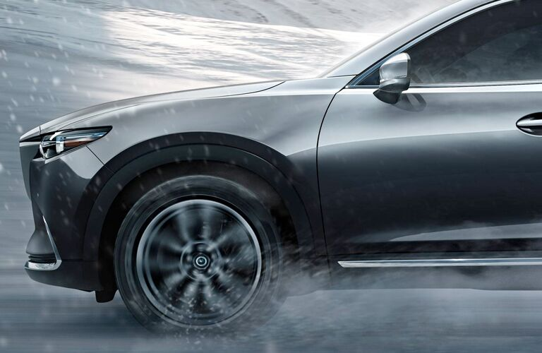Front view of silver 2019 Mazda CX-5 driving on snowy road