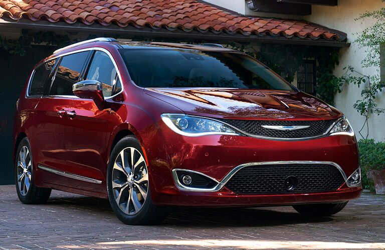 Front passenger angle of a red 2019 Chrysler Pacifica