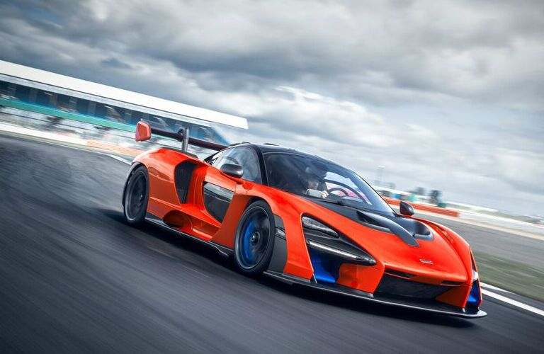 Orange 2019 McLaren Senna driving on a racetrack