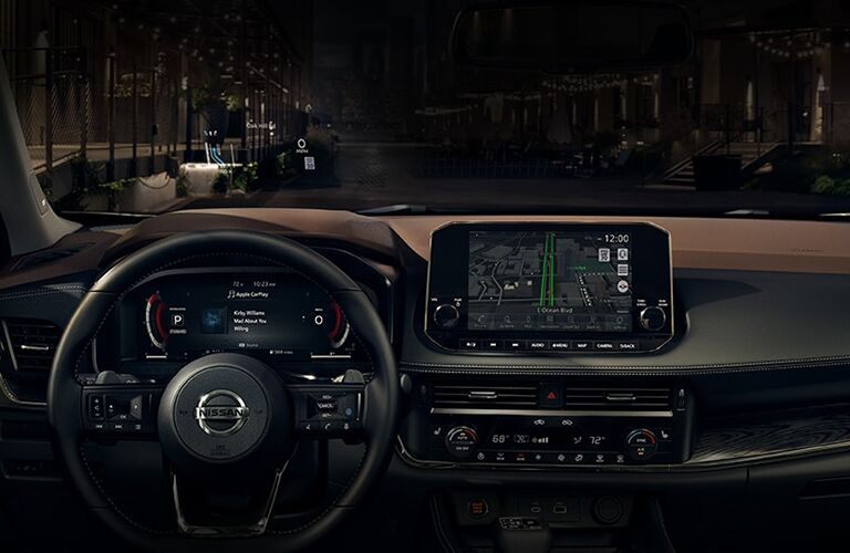 Interior driver area of the 2021 Nissan Rogue as seen at night