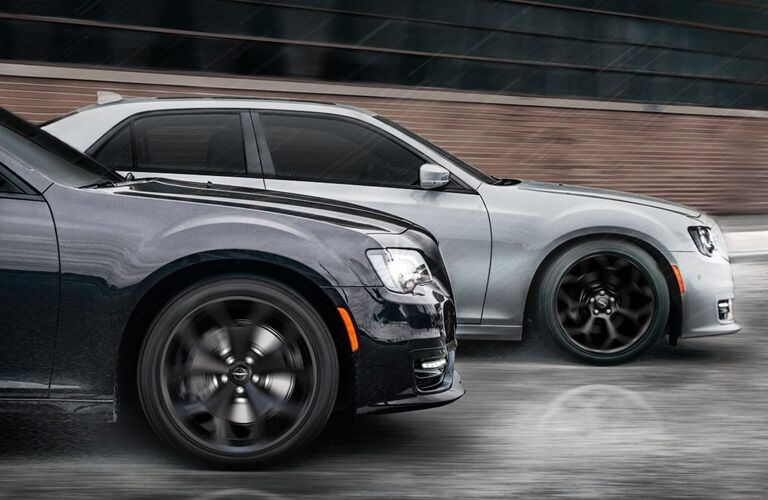 Two 2020 Chrysler 300 sedans going down the road