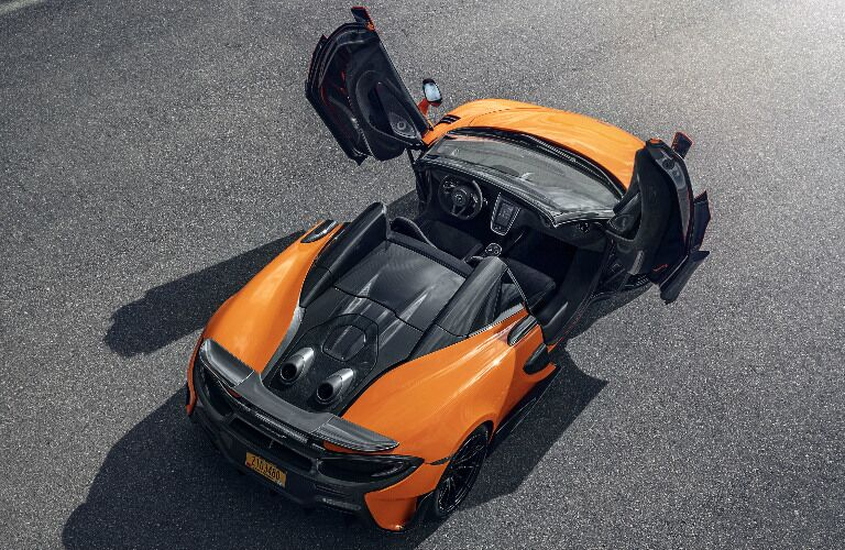 Overhead view of orange 2020 McLaren 600LT Spider with its butterfly doors opened