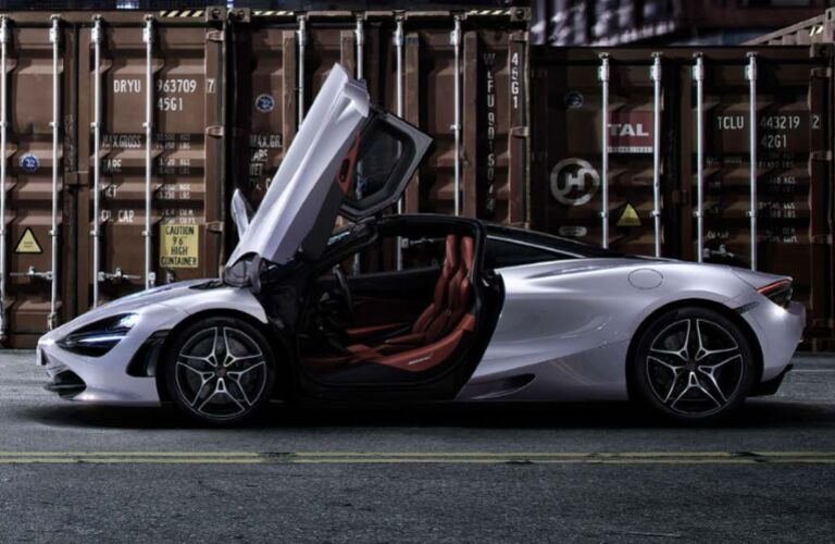 Silver 2020 McLaren 720S parked next to a shipping container