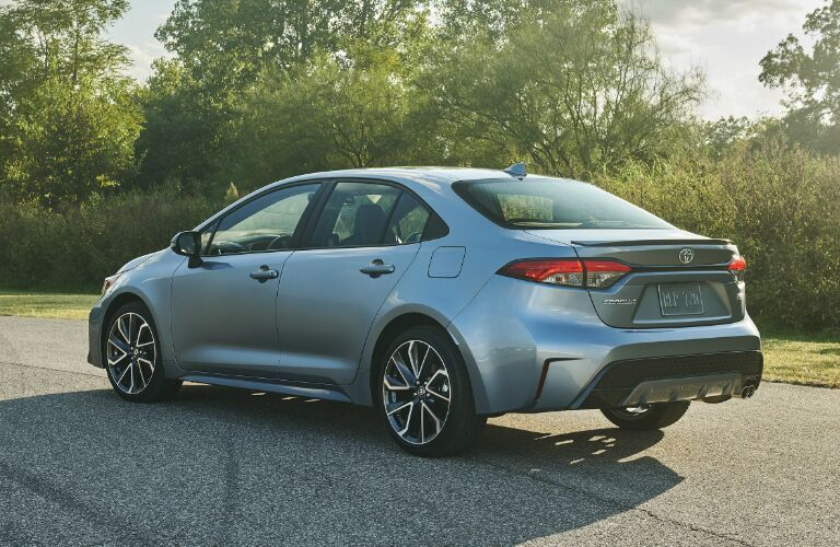 Driver's side rear angle view of light blue 2020 Toyota Corolla