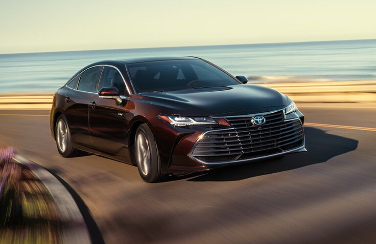 2020 Toyota Avalon Hybrid driving around a corner