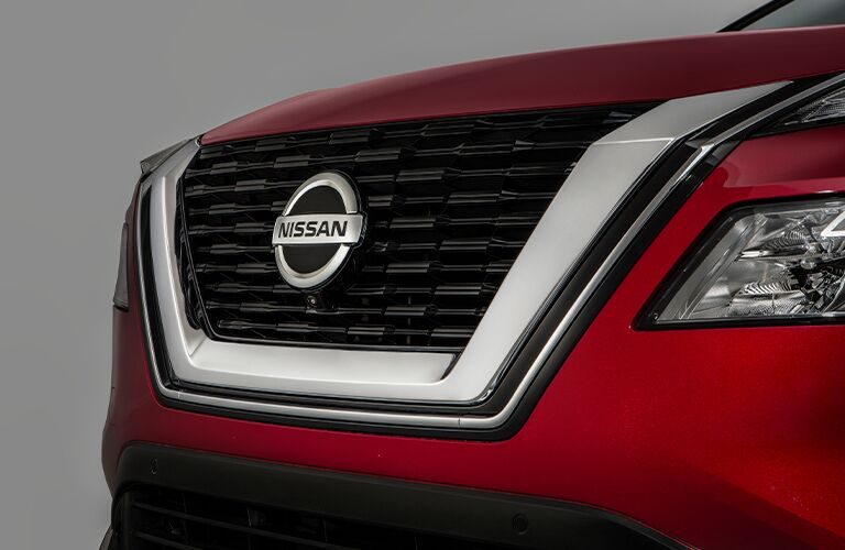 Front exterior view of a red-colored 2021 Nissan Rogue