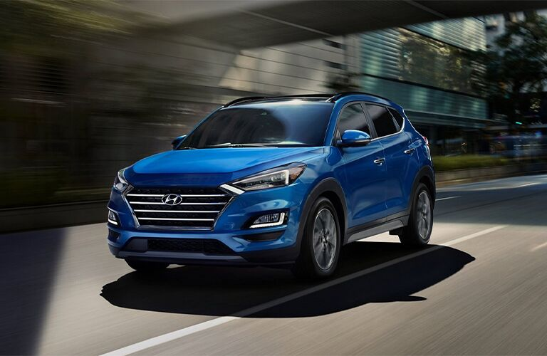 2021 Hyundai Tucson exterior front fascia driver side on blurred road under bridge