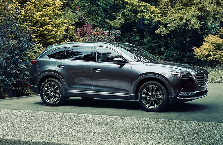 2020 Mazda CX-9 parked on concrete outside near trees.