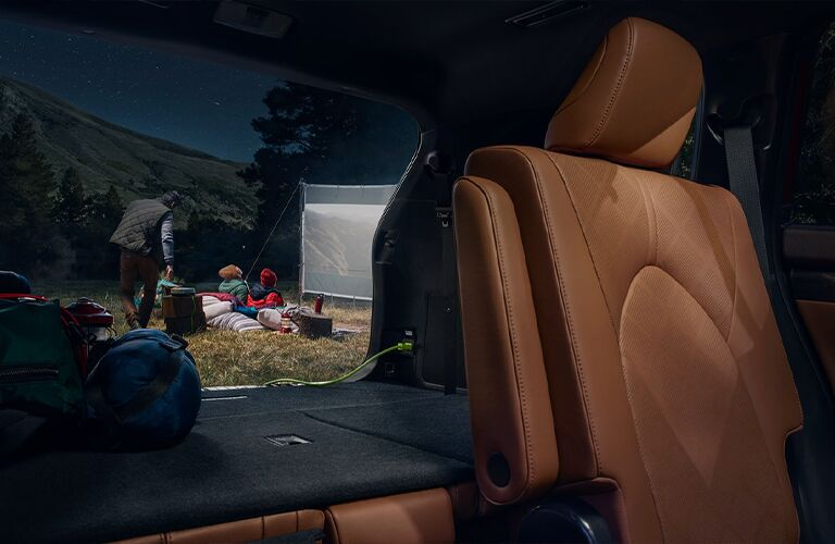 The rear interior seating view inside the 2021 Toyota Highlander Hybrid.