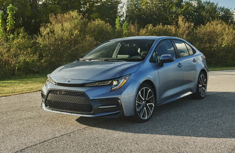 Driver's side front angle view of light blue 2020 Toyota Corolla