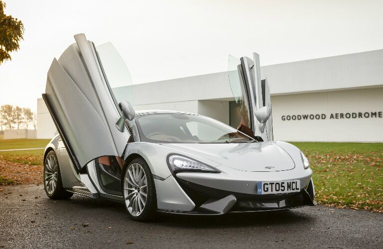 Butterfly (dihedral) doors opened on silver 2019 McLaren 570GT