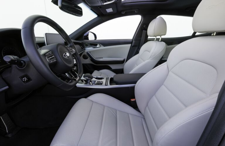 Dark grey dashboard and light grey front seats in 2020 Kia Stinger