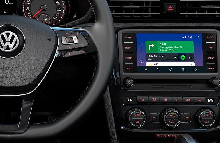 Interior view of part of the steering wheel and the touchscreen display inside a 2020 Volkswagen Passat