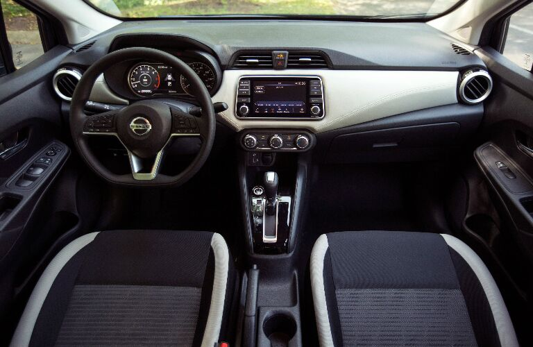 Multi-tone grey dashboard and front seats in 2020 Nissan Versa