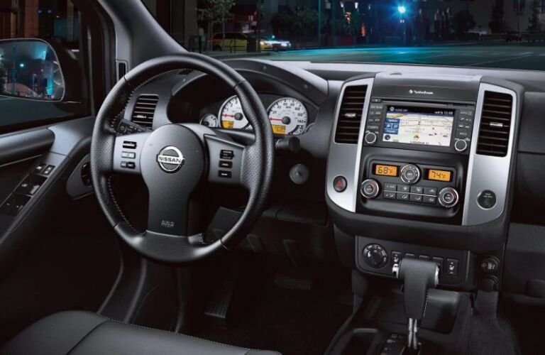 Steering wheel, gauges, and touchscreen in 2019 Nissan Frontier