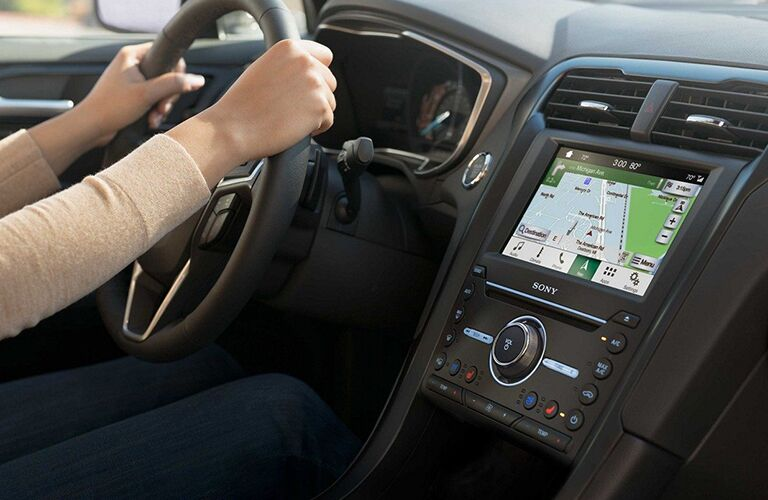 Hands gripping 2019 Ford Fusion steering wheel