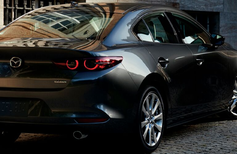 The rear view image of a gray 2021 Mazda3 Sedan.
