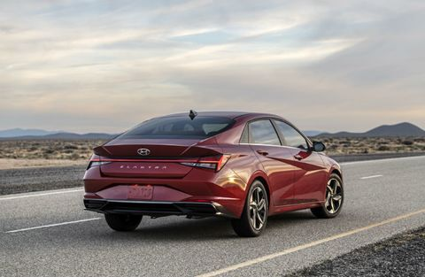 The rear view of a red 2021 Hyundai Elantra.