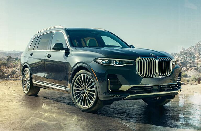 Passenger's side front angle view of blue-grey 2019 BMW X7