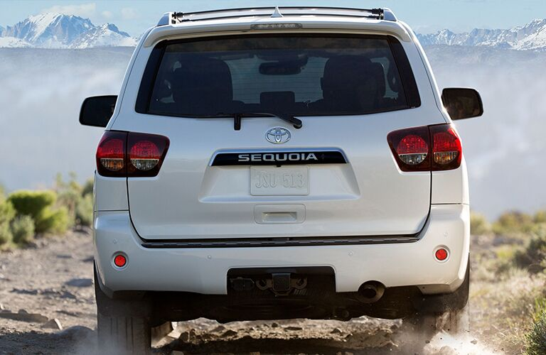 2020 Toyota Sequoia rear view on a dirt road
