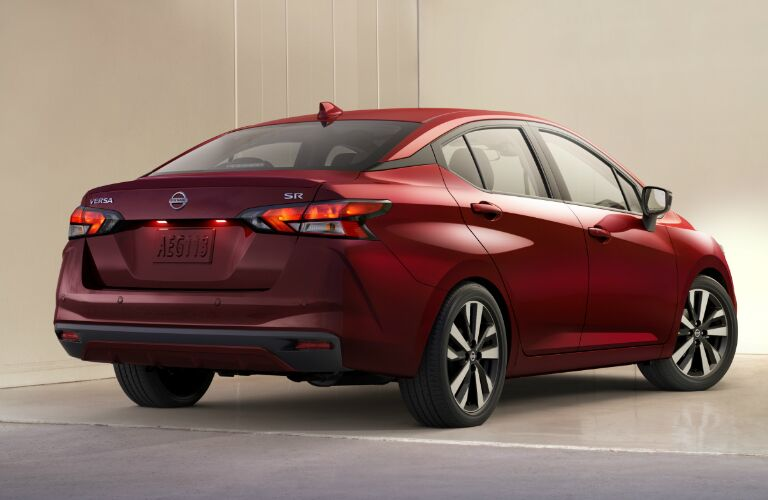 Rear view of red 2020 Nissan Versa