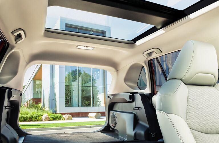 The rear interior cargo space and available sunroof inside the 2021 Toyota RAV4 Hybrid.